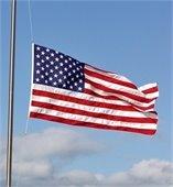 United States flag flying at half staff